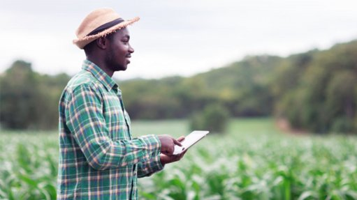 A farmer having connectivity out in the field