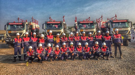 An image/photo of BME Indonesia staff and trucks