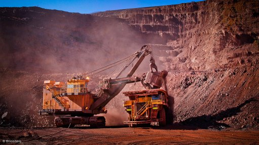 Image of large mining vehicles at an iron-ore mine