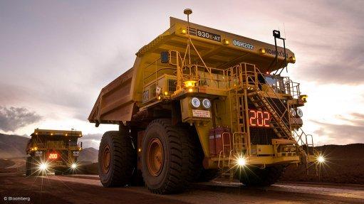 Image of large mining trucks