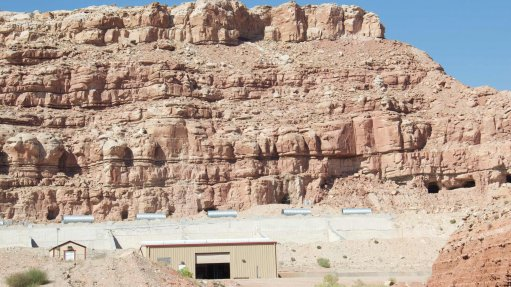 An image showing a hill and a mine administrative building in Utah, US.
