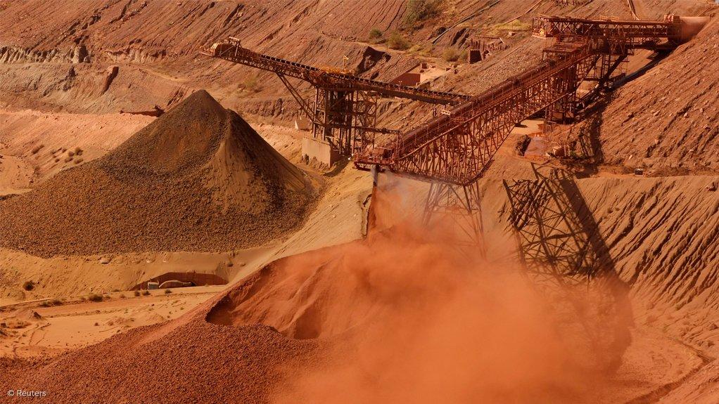Image shows iron-ore stockpiles at BHP's Pilbara operations