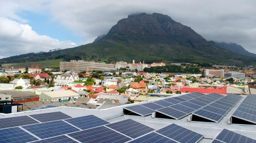 Image of solar rooftops with a Cape mountain in the background