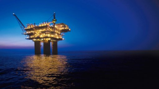 An image showing an oil rig at night