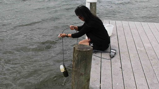 Photo of woman testing water quality