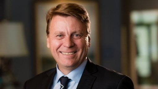 An image showing Newmont CEO Tom Palmer smiling.