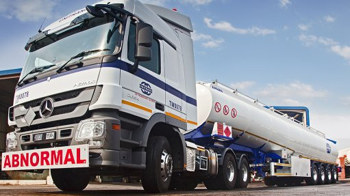 An image of a large Unitrans truck bearing an abnormal loads sign