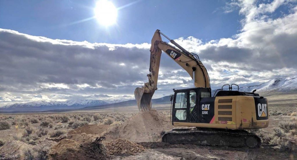 An image of an excavator operating at a mining site in Nevada.
