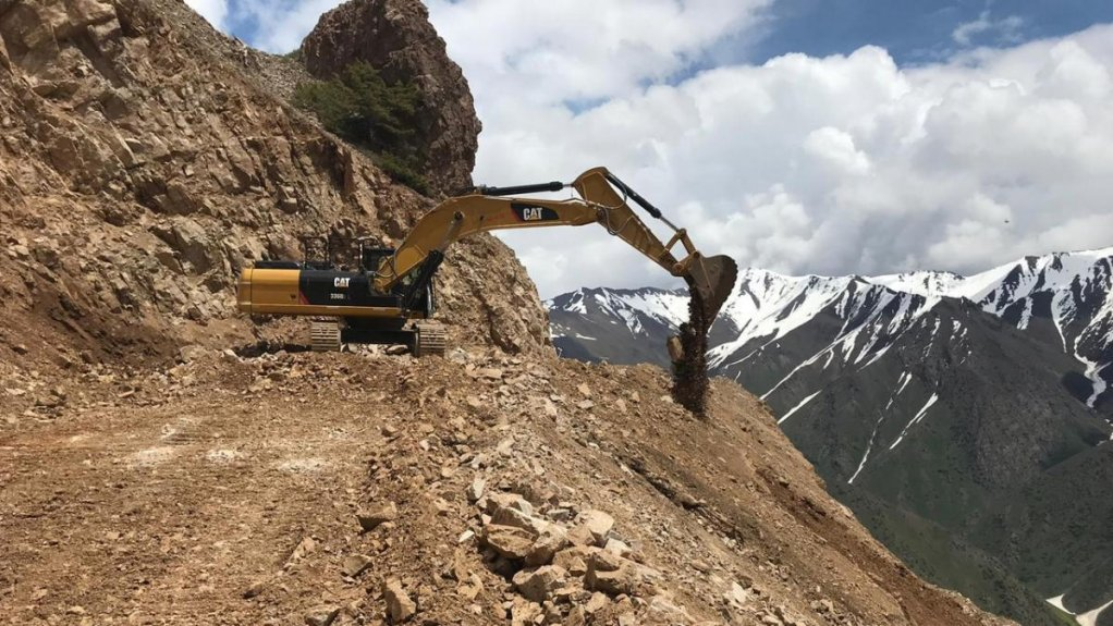 An image of an excavator operating.