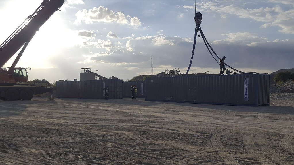 Storage containers being offloaded as part of site establishment