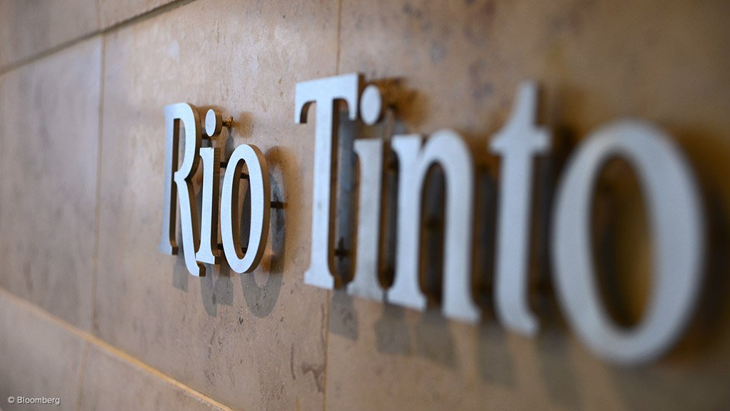 Image is of the Rio Tinto logo outside of its head office