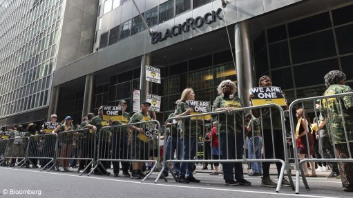 An image showing Members of the United Mine Workers of America picket during a strike against Alabama's Warrior Met Coal at the BlackRock offices in New York.