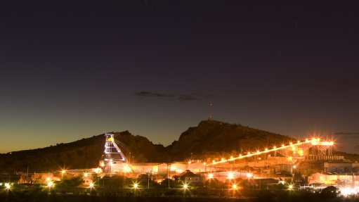 An image of a mine processing facility at night.