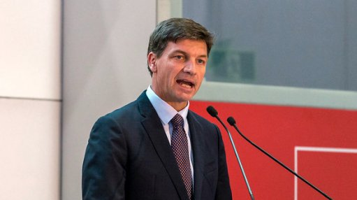 An image of Australian Energy and Emissions Reduction Minister Angus Taylor speaking at an event.
