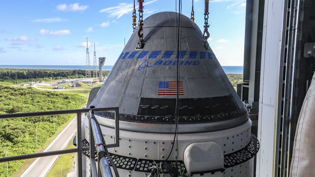 An image of the Starliner capsule being integrated with the Atlas V rocket