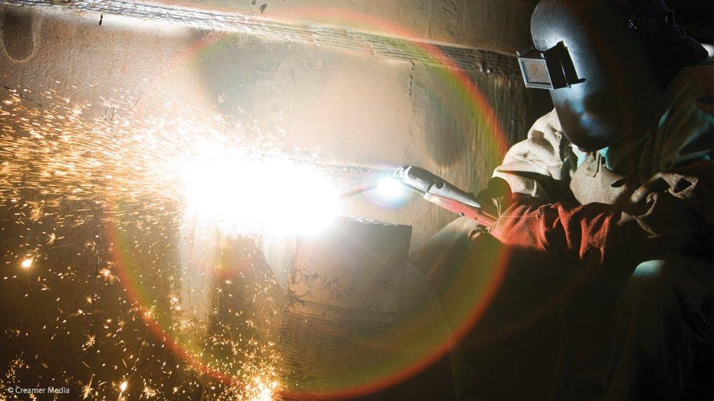 A photo of a worker welding