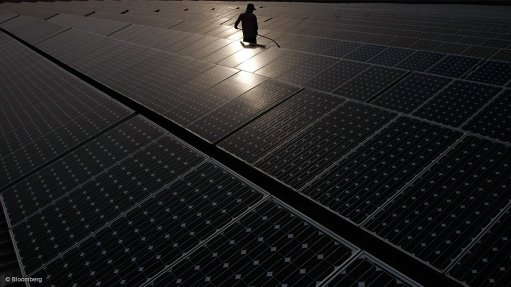 An image showing solar panels being cleaned at a power station in New Delhi