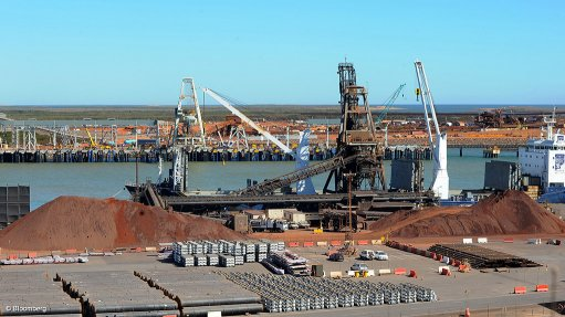 Image depicts a ship loading ore at the Port of Port Hedland