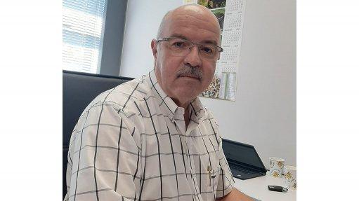 Rosond Director Carlos Da Silva sat at a desk discusses Platinum Group Metals