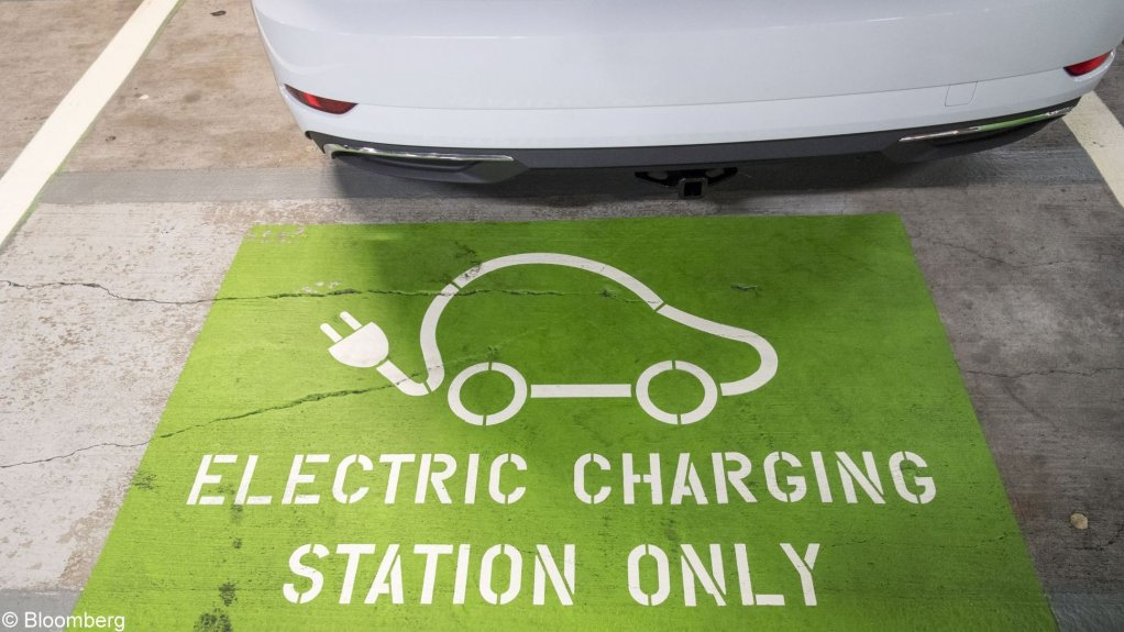 An image showing a parking space for an electric vehicle to recharge.