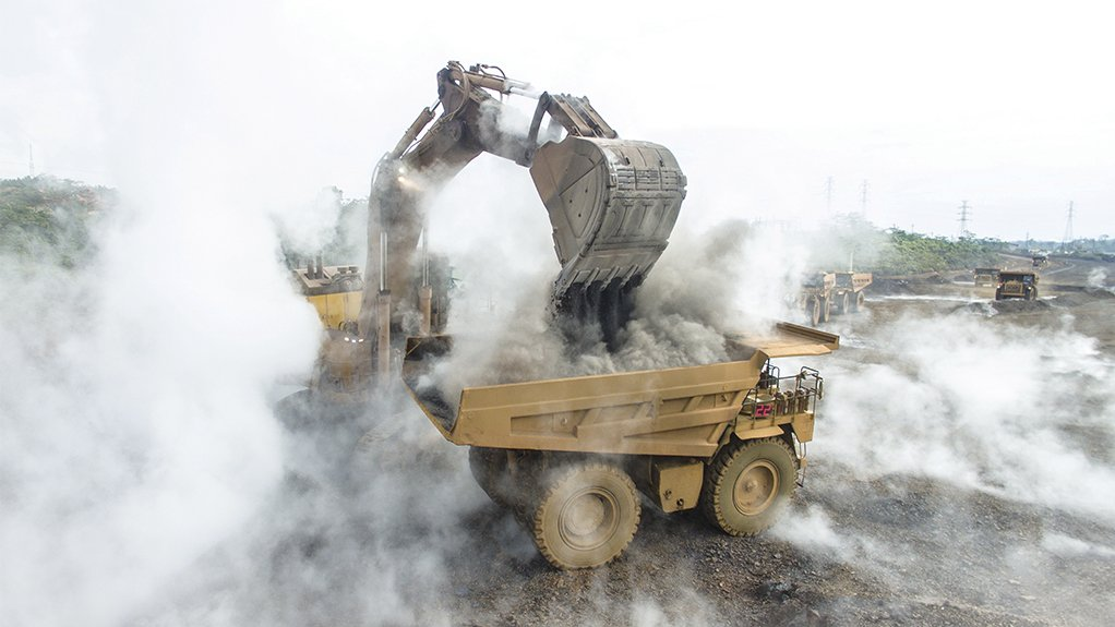 Picture of an excavator loading rubble into a dumb truck