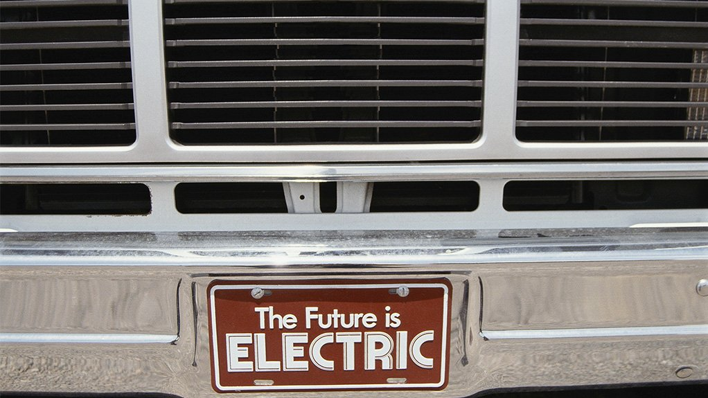 """A photo of a car bumper with a license plate that says """"The Future is ELECTRIC"""""""