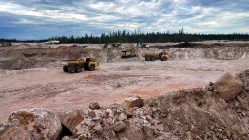 An image of heavy equipment working on a mine site in Canada.