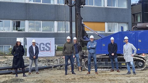 Staff at SGS Group standing in front of a site being constructed at its better testing facility in Spijkenisse near the Port of Rotterdam