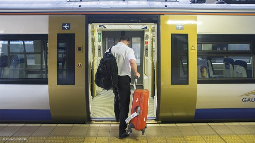 Image of a passenger boarding the Gautrain