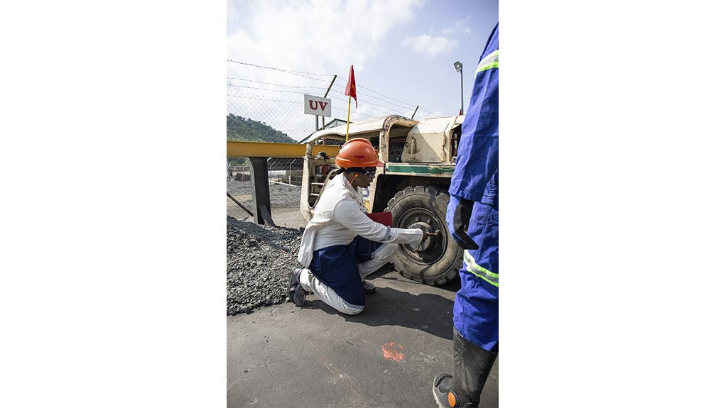 An image of the Sisi workwear and footwear being used in the feild