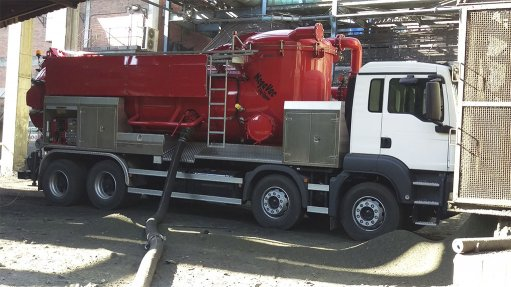 An image of a large red truck fitted with vacuum pump and tank used for acid plant sludge spillage recovery