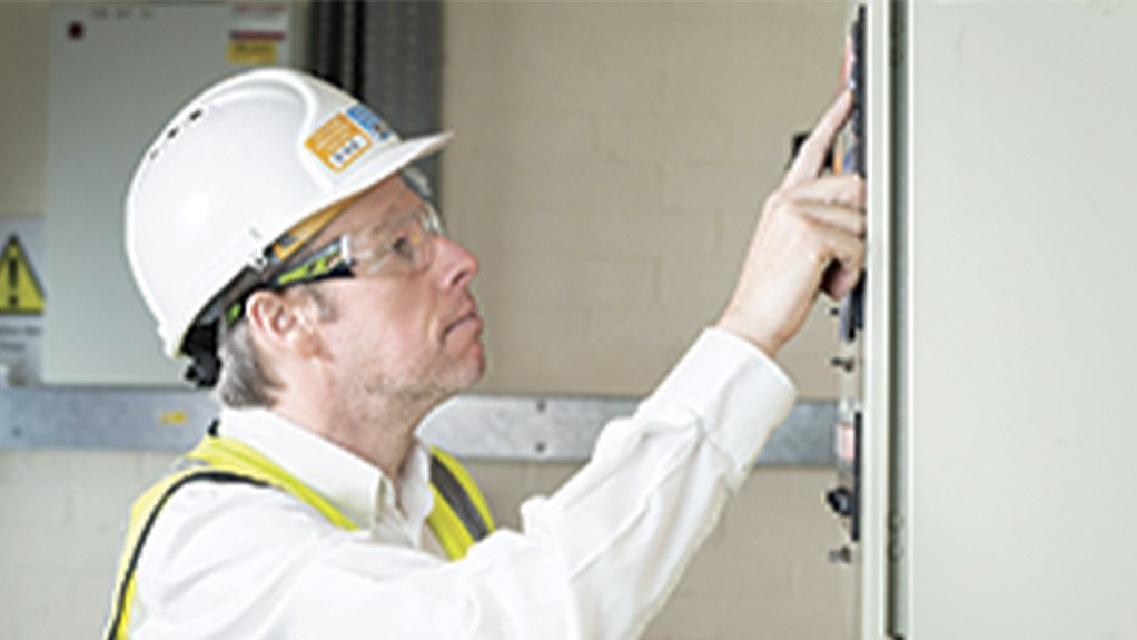 An image of a man checking the alarm system