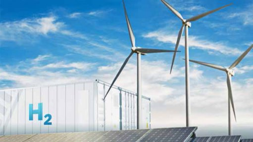 Image depicts hydrogen storage units and wind turbines