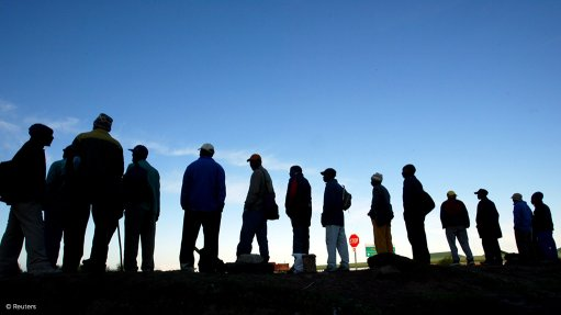 Unemployed people standing in line