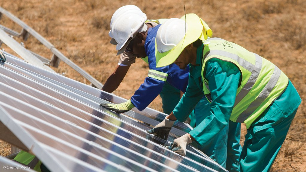 Photo of workers installing solar panels at a project in South Africa
