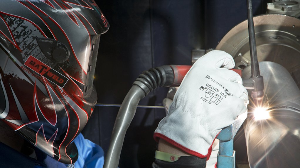 Image of a welder working in an aerospace manufacturing facility