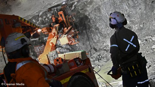 a picture of miners at the Booysendal South mine work on constructing a new decline shaft