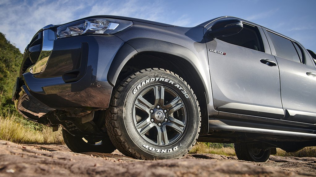 A photo of the Dunlop Grandtrek AT3G two-ply white lettering tyre on a SUV