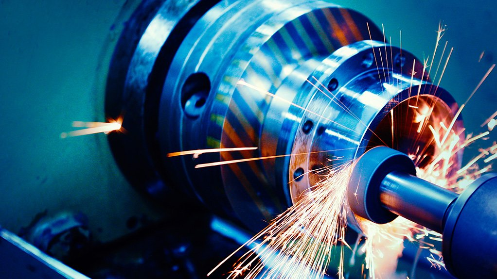 A close-up photo of precision tooling in action with sparks flying