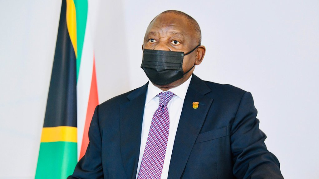 President Cyril Ramaphosa in a face mask as he prepares to answer questions during a hybrid sitting of Parliament on Friday