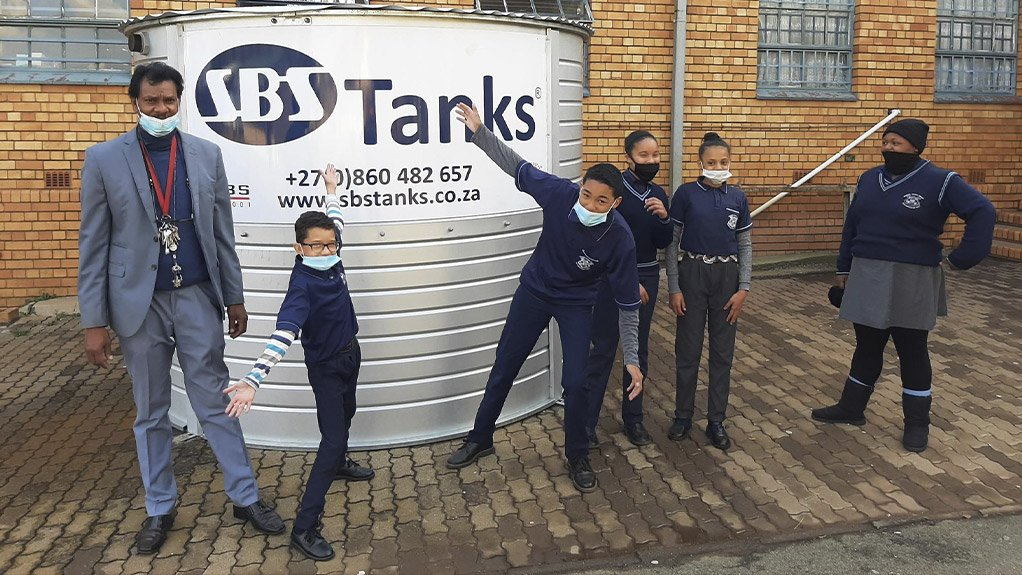 Bernard Isaacs Primary Principal, Danny Reddy and learners are excited about their new SBS water tank that will give them access to water all day, regardless of municipal water cuts