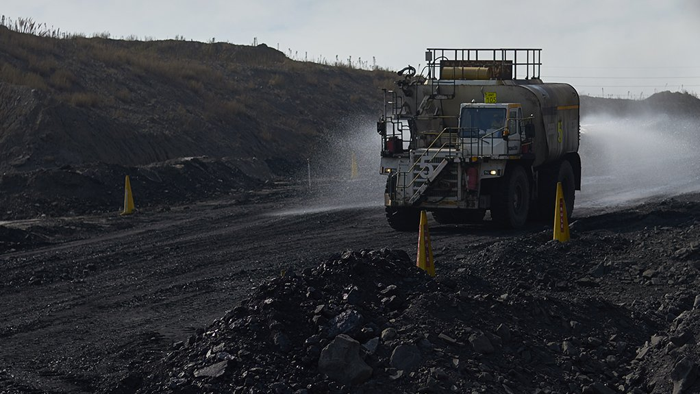 A large Mining mining truck moving through a coal fiel at Kriel Colliery mine in South Africa