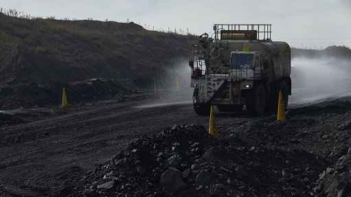 An image of a large mining truck moving through a coal field at Kriel Colliery mine in South Africa