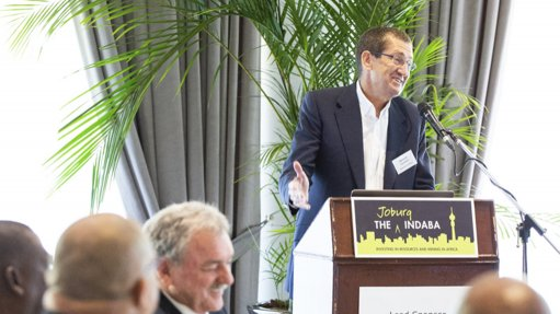 An image of host and master of ceremonies Bernard Swanepoel at a podium hosting a pre-Covid-19 Joburg Indaba, and engaging with delegates
