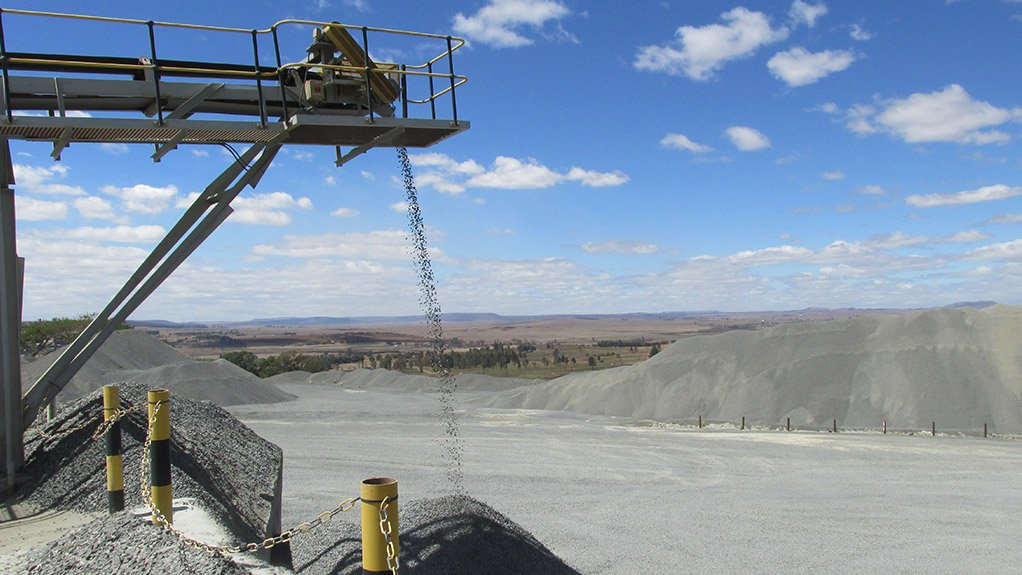 An opencast operation with product pouring onto a pile