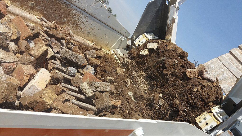 A photo of construction and demolition waste being screened