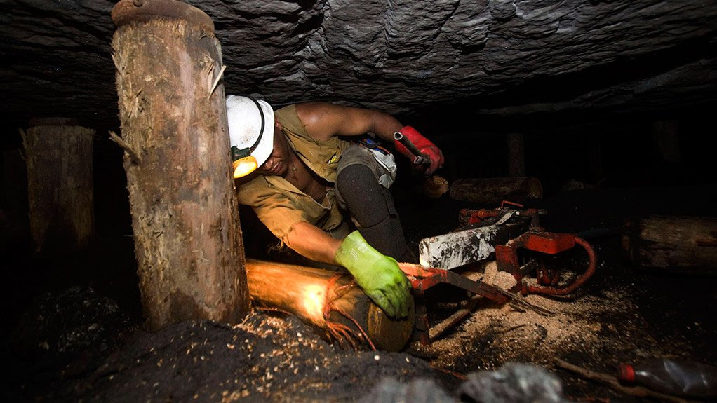 A photo of a mineworker in a South African underground mine