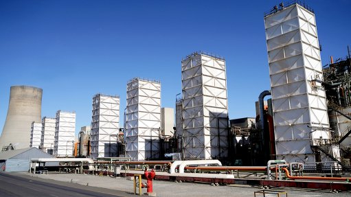 A photo of seven air separation units and a pylon in the background