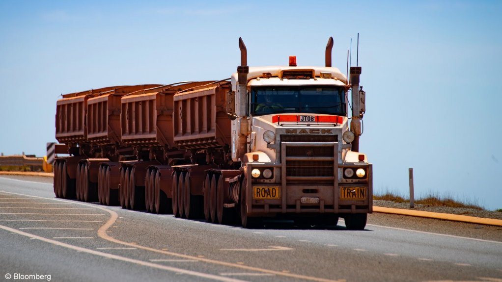A truck transporting iron-ore.