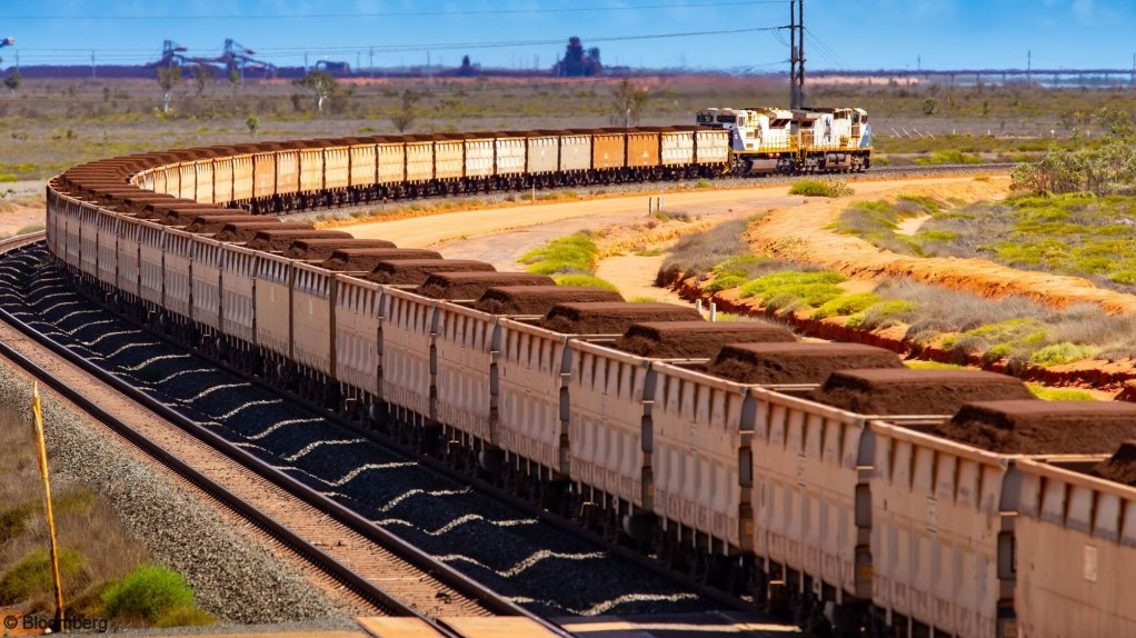 An image of a freight train carrying iron-ore